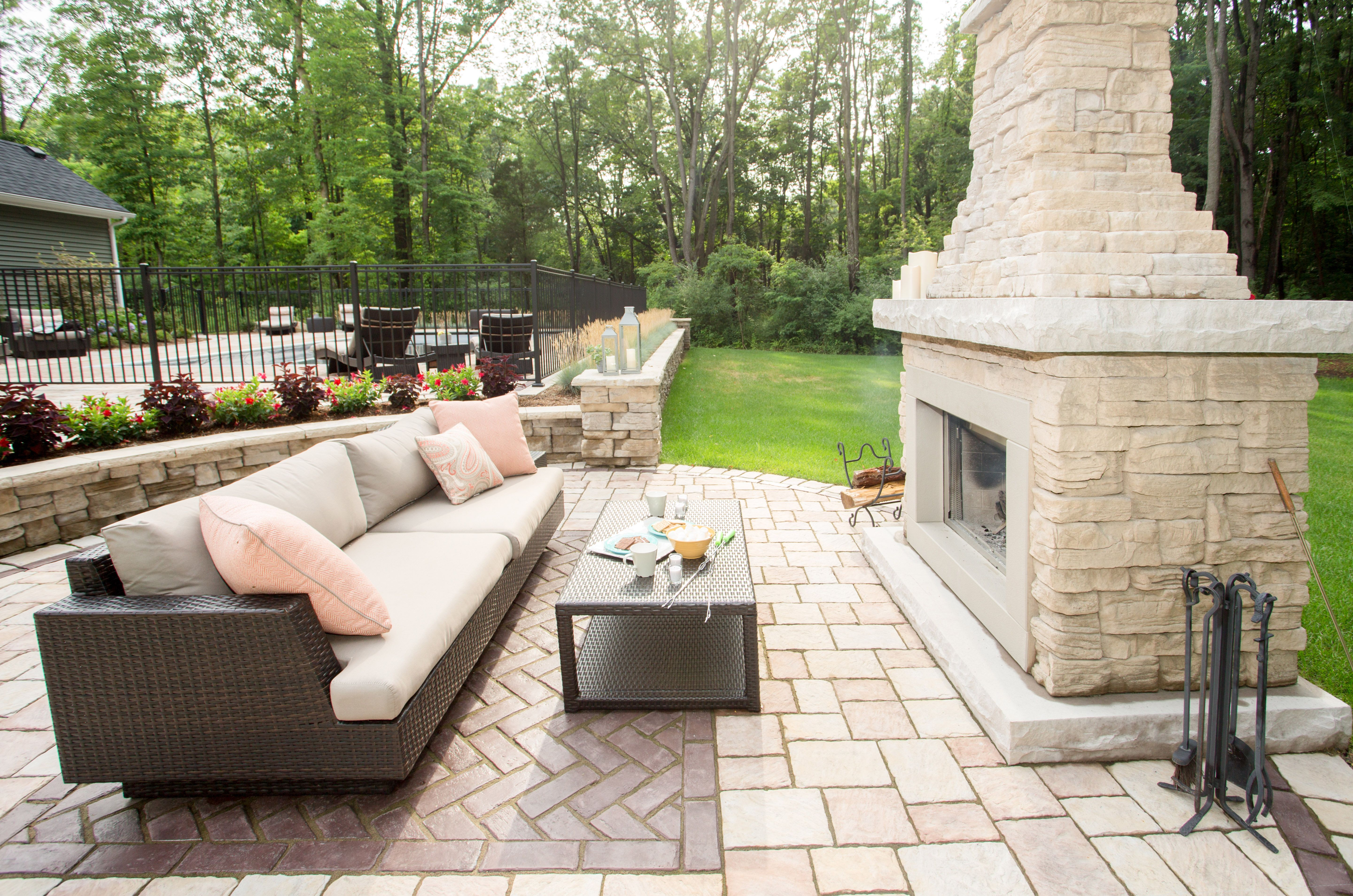 Outdoor couch next to a warm Belvedere Fireplace