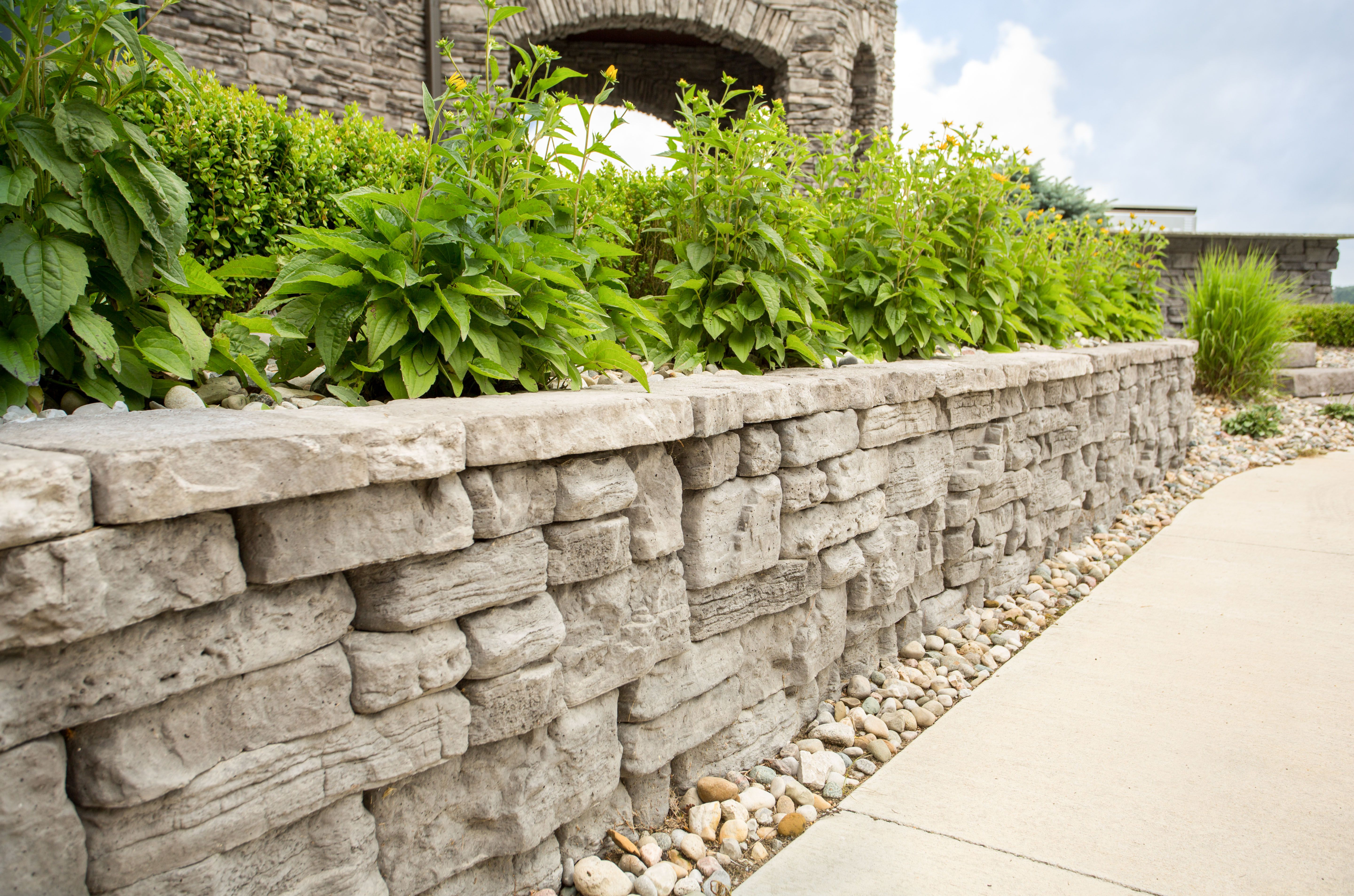Belvedere retaining wall with lush green landscaping