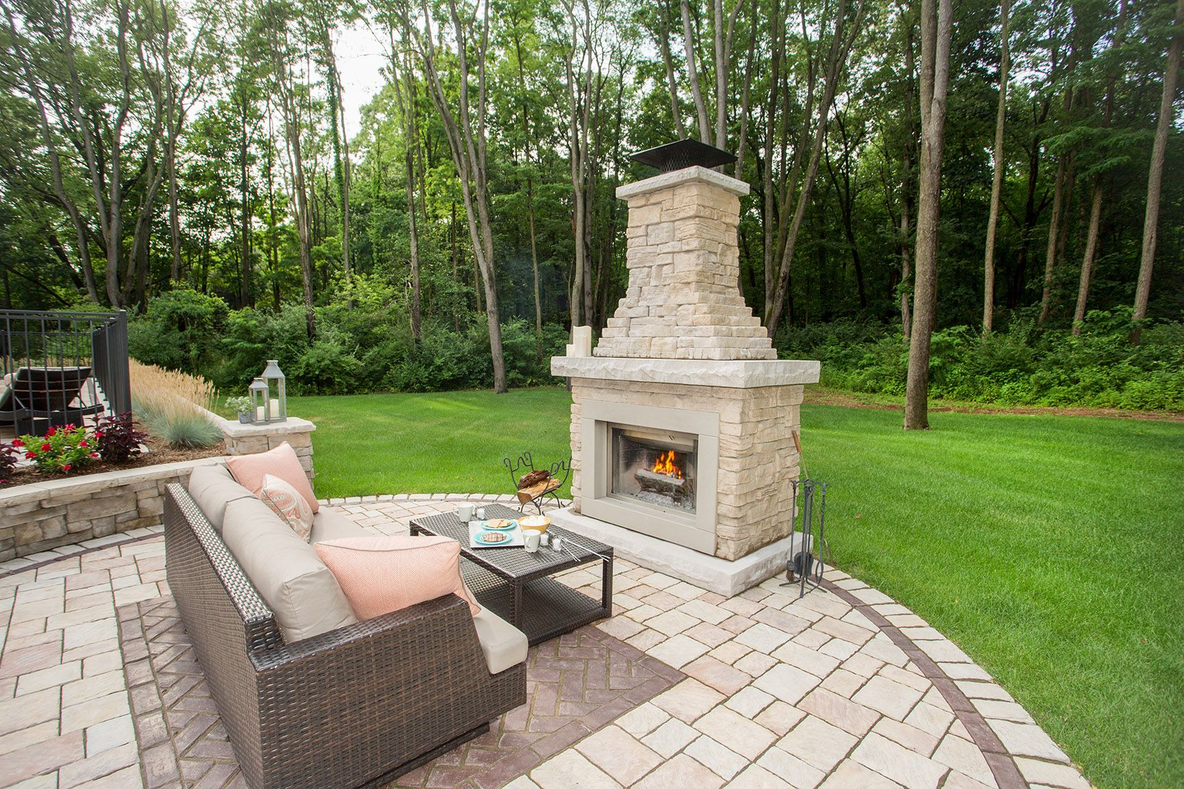Backyard fireplace provides an anchor for outdoor living