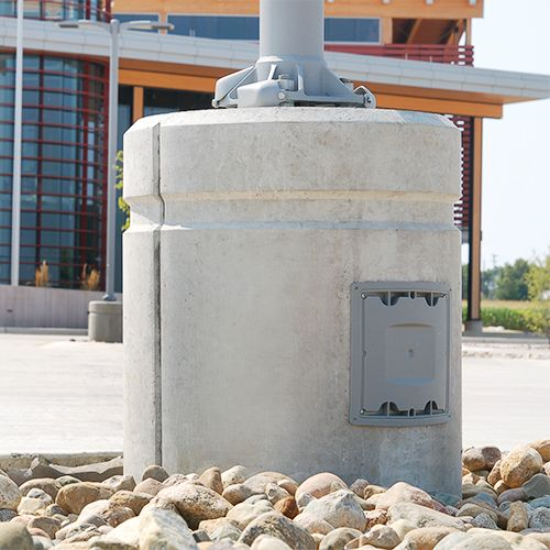 Pole Base close up with gray junction box