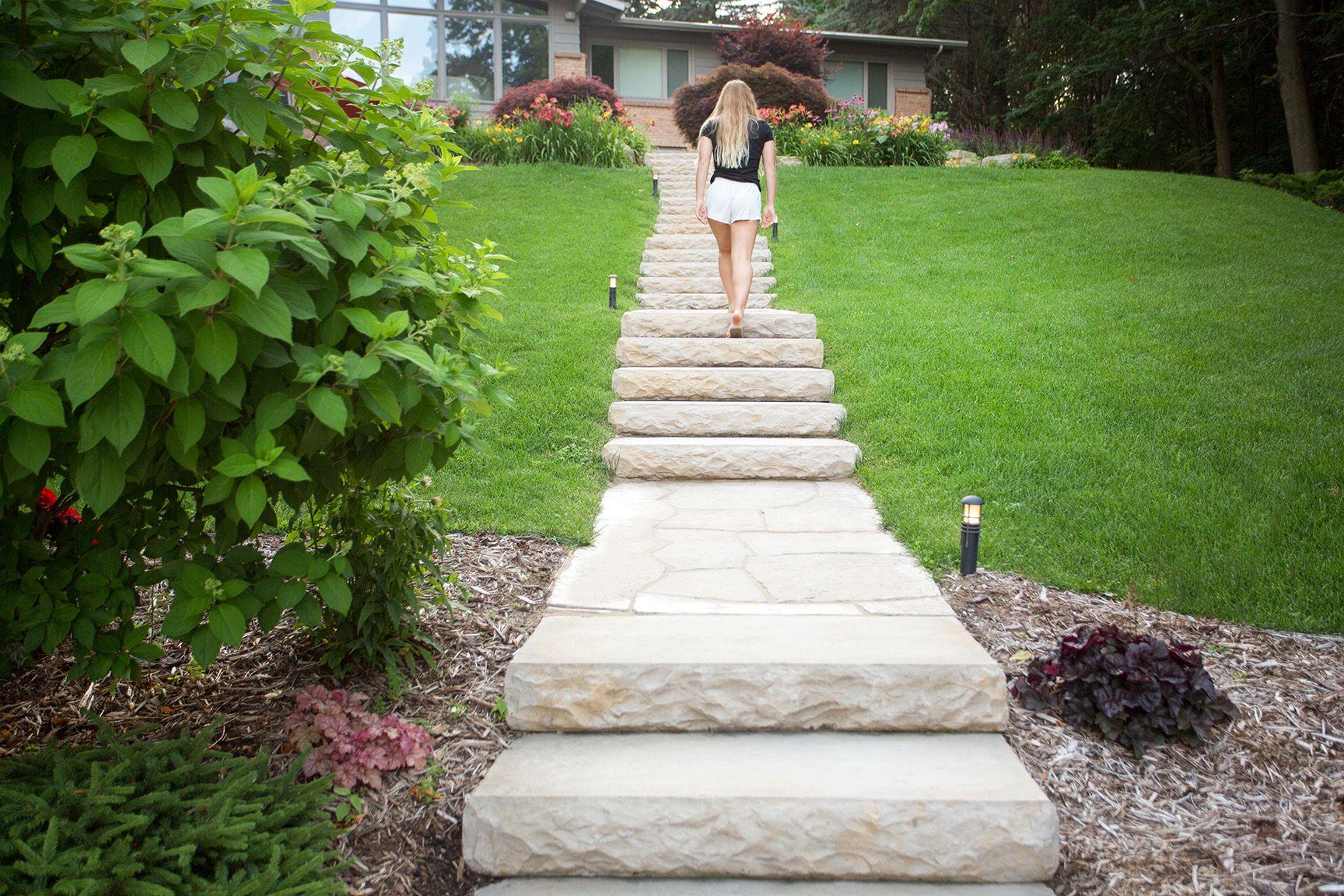 Girl walking up Rosetta Dimensional Step stairway