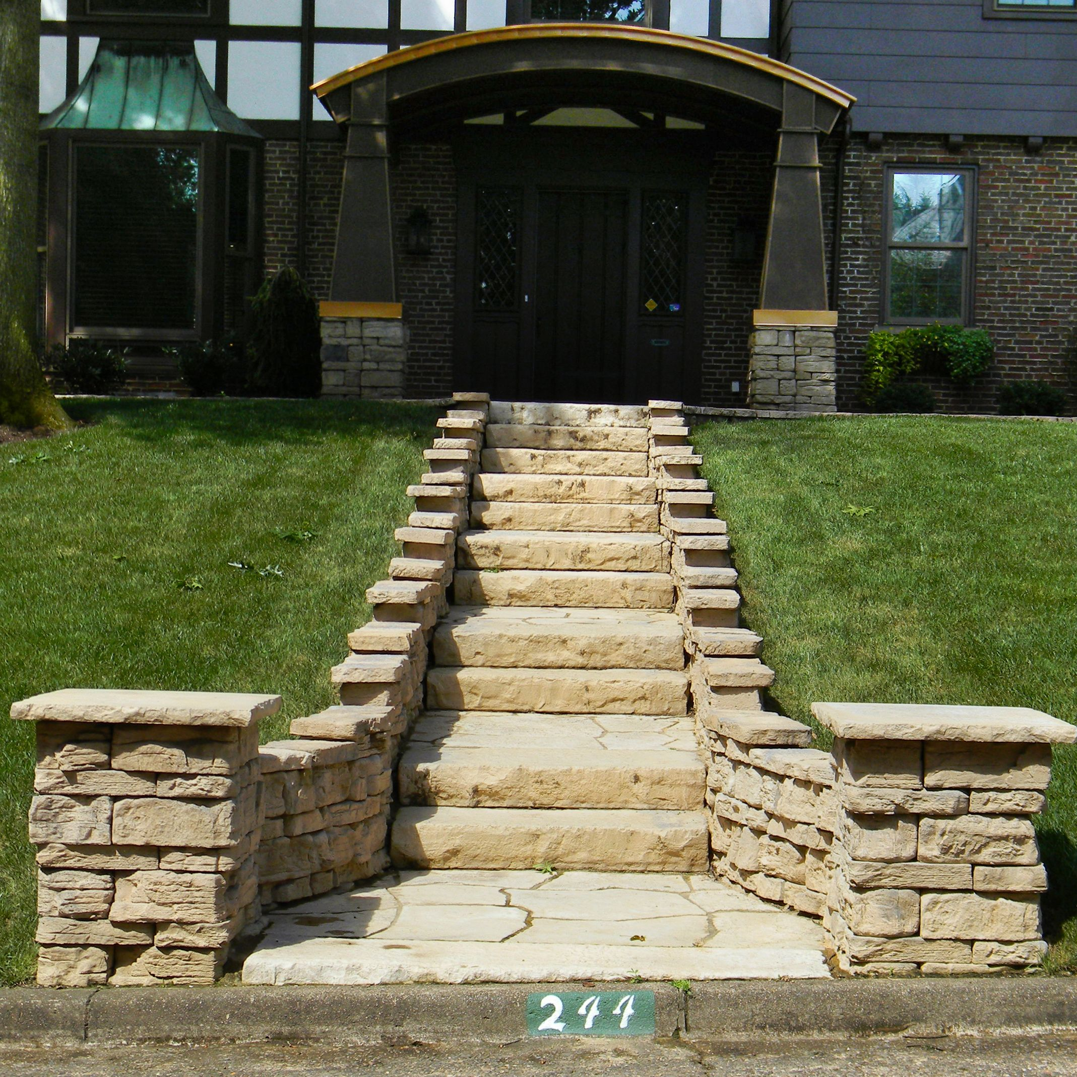 Stairway lined with Belvedere wall and Belvedere coping leading to front entrance