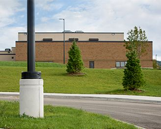 Petoskey High School project light pole foundation with round rusticated detail