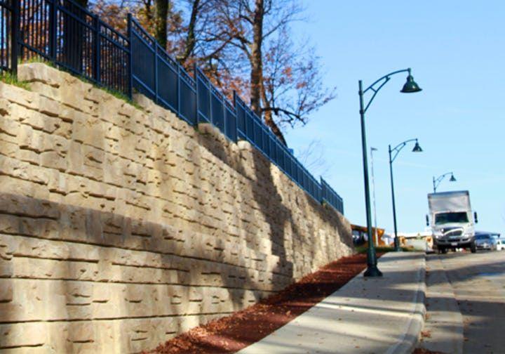 Ledgestone retaining walls with iron fence on top