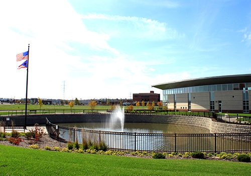 A retention pond with a fountain in the middle