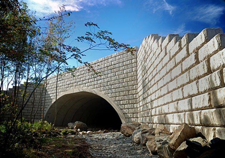 Limestone retaining walls create bridge for water culvert