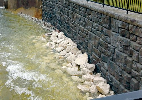 Ledgestone retaining wall creates structurally sound storm channel