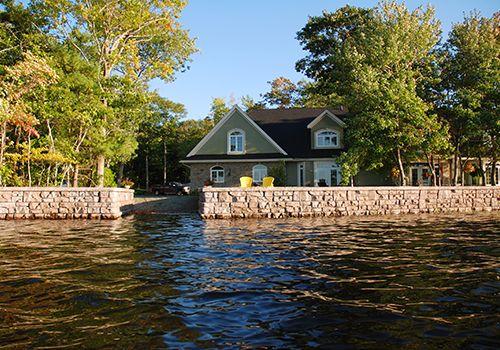 Redi-Rock Ledgestone wall creates shoreline protection for lakeside home
