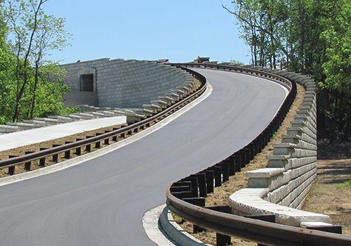 Limestone retaining walls create roadway ramp