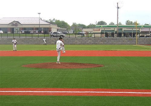 Pitcher winding up to throw