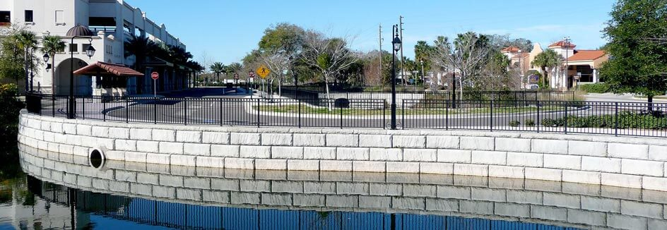 Caps line a curving retainign wall