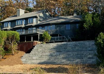 Home Protected from Erosion with 9in Setbacks Blocks and Soil Anchors
