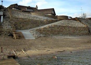 Ledgestone Walls Protect Home From Erosion