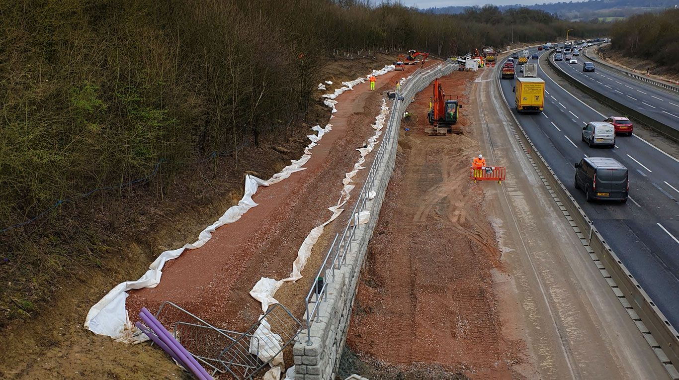 Retaining wall installation on side of highway