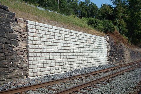 A Redi-Rock wall used to repair a failed stone and mortar wall
