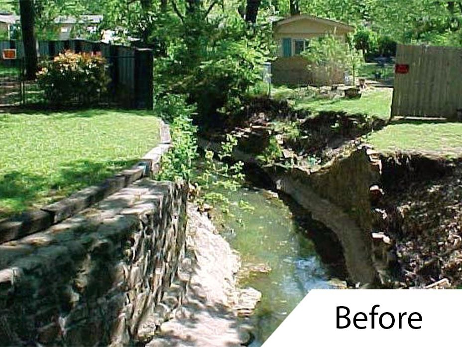 Preconstruction photo of damaged channel retaining wall in neighborhood