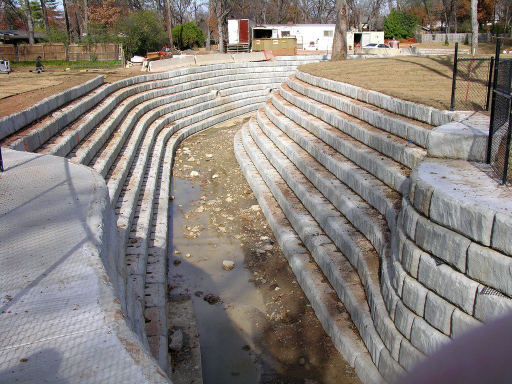 Curved Limestone retaining walls used to support channel and slow the flow of water