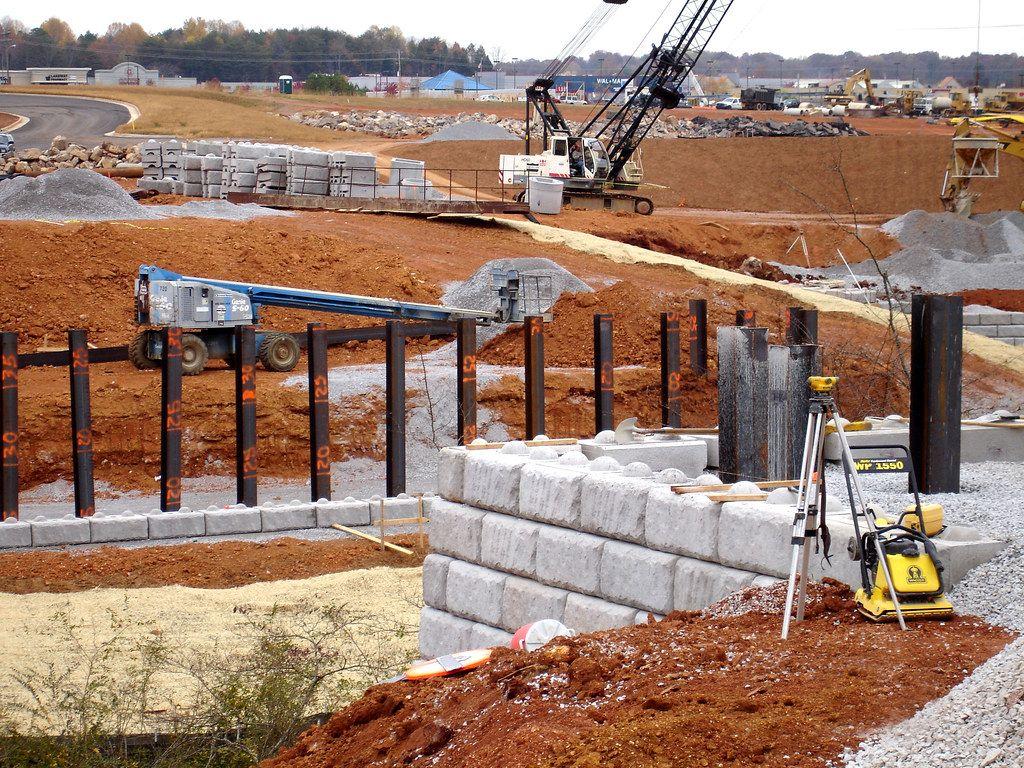 Installation of Redi-Rock retaining wall blocks for bridge