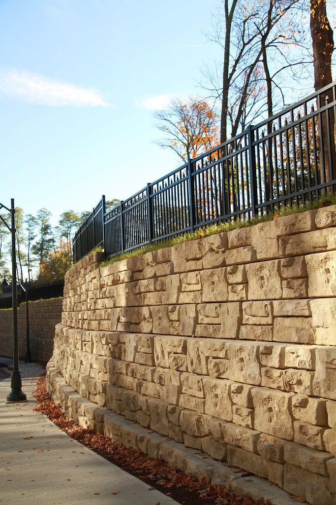 Curved Ledgestone retaining wall alongside sidewalk