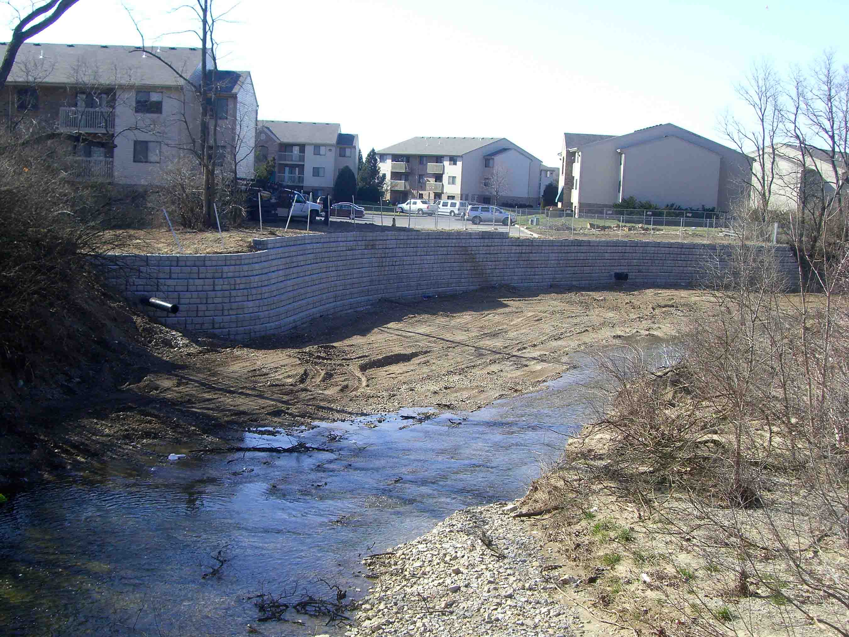Cobblestone retaining wall built for erosion control at apartment complex