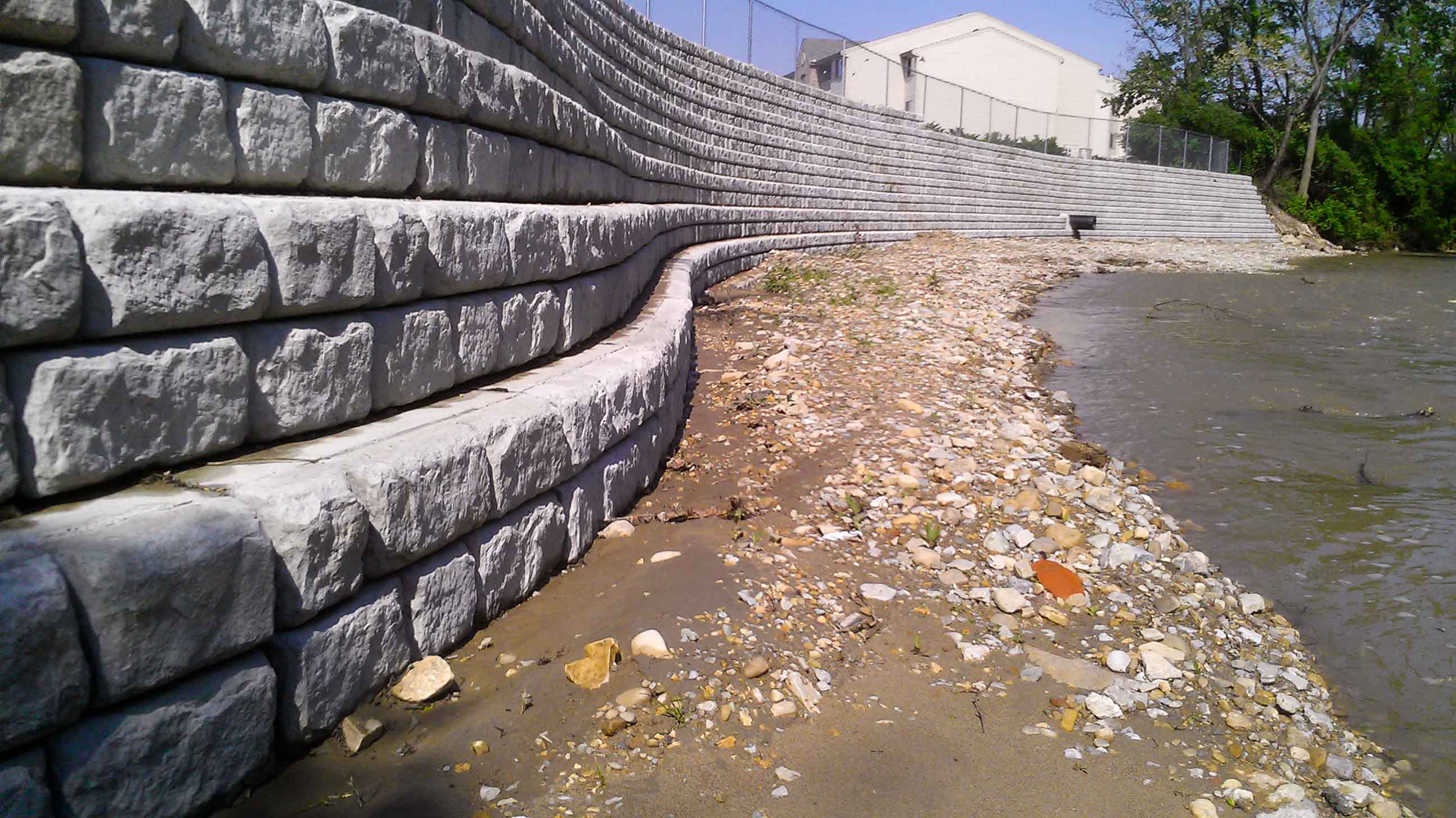 Curved Cobblestone retaining wall with setbacks for erosion control