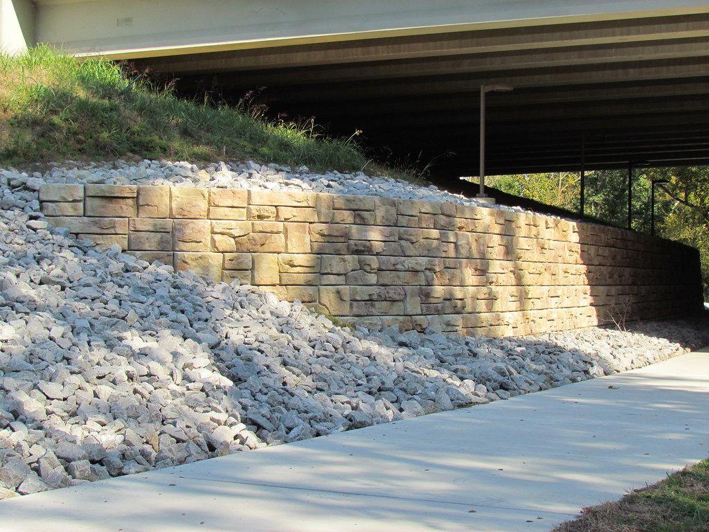 Ledgestone retaining wall provides stabilization to overpass