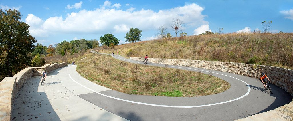 Curved Ledgestone retaining wall provides structure to bike path