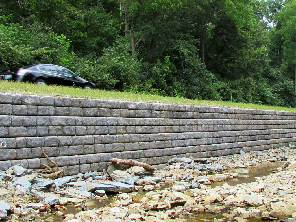Cobblestone retaining wall supporting roadway