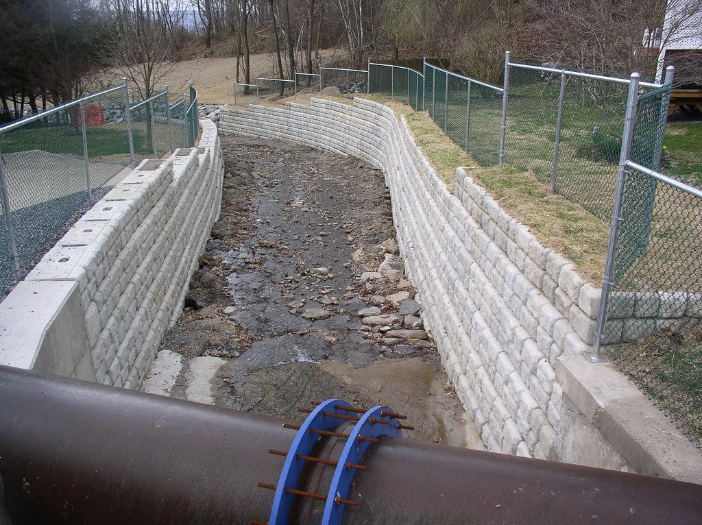 Newly restored Coal Creek storm channel with Cobblestone retaining walls