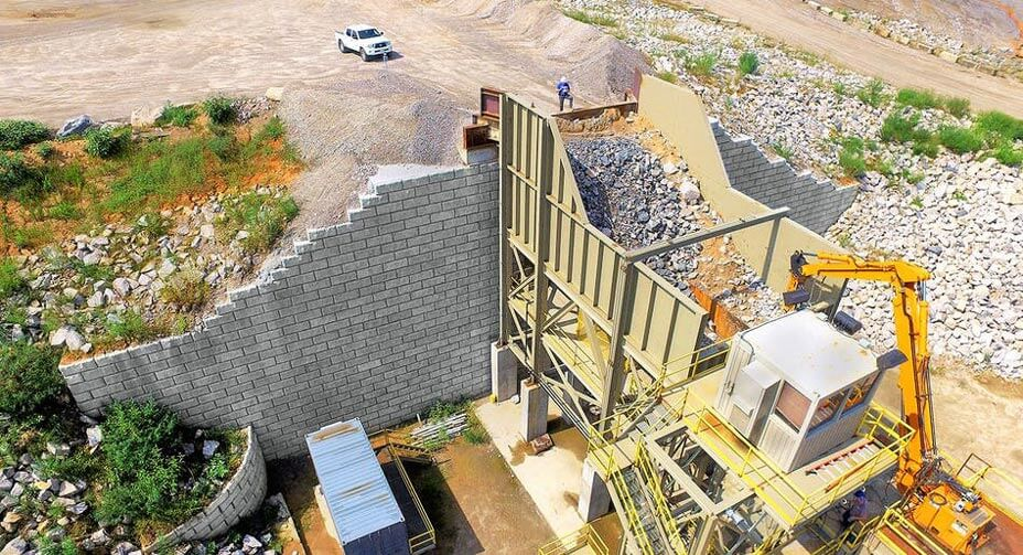 A 51-foot tall wall adjacent to a primary crusher at a quarry