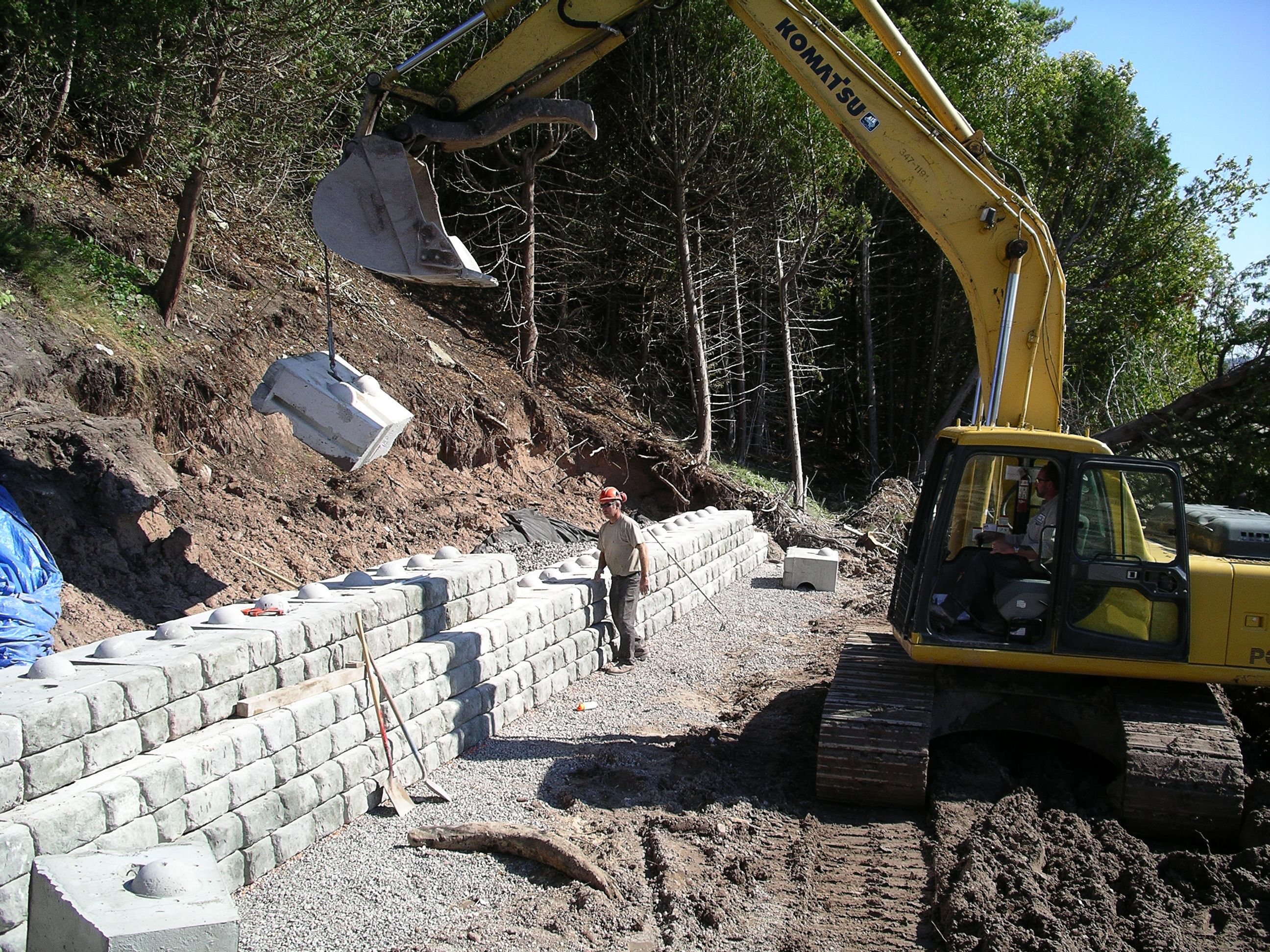 Installation of retaining wall with 9in (230mm) setback