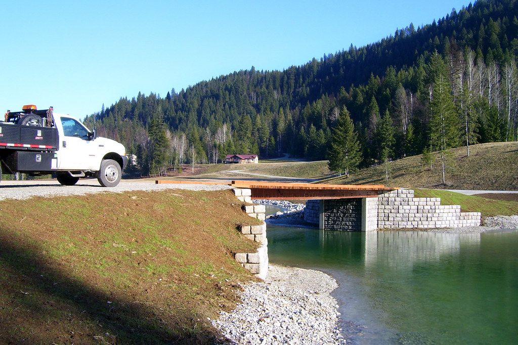 Truck heading toward bridge supported by Redi-Rock fin walls
