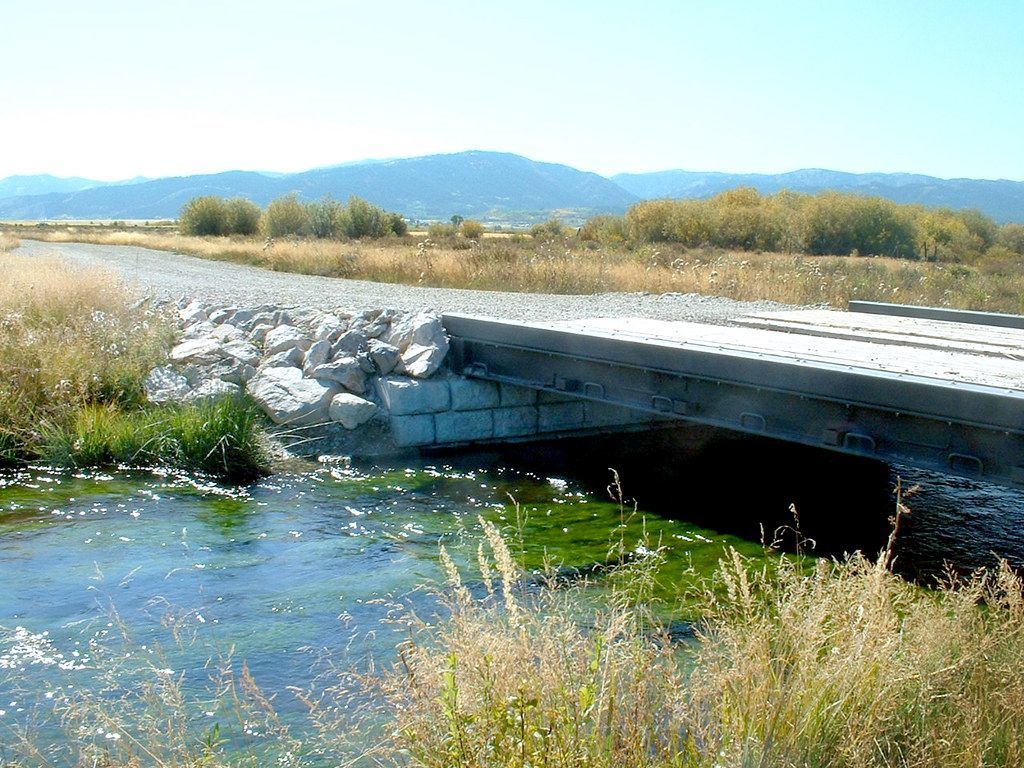Recycled rail car used as bridge over stream