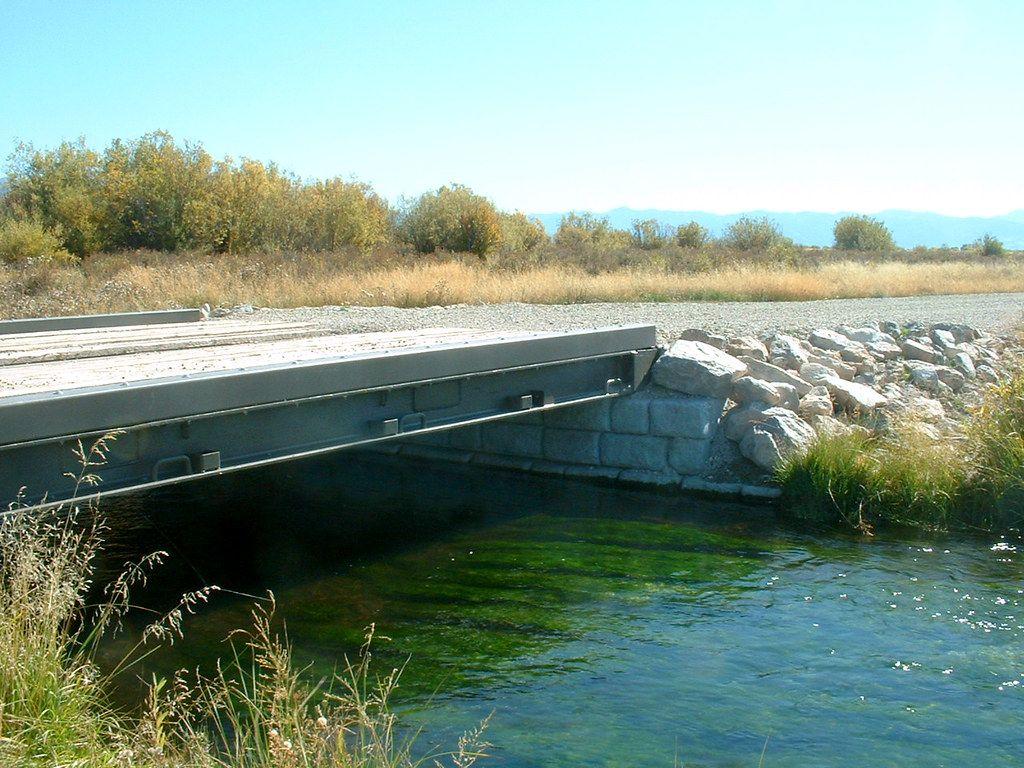 Cobblestone gravity blocks support small bridge