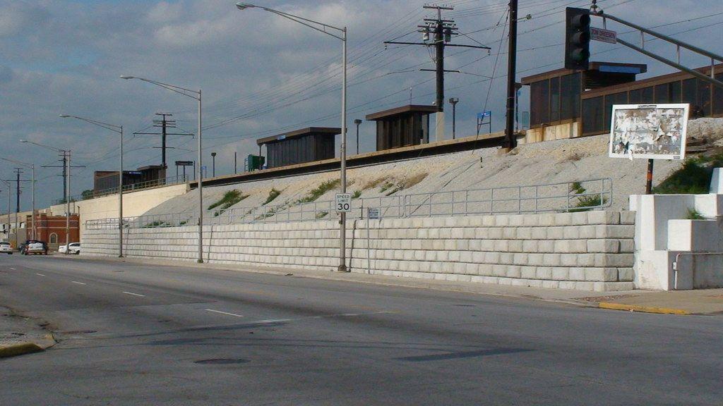 Limestone retaining wall below a Metra train station