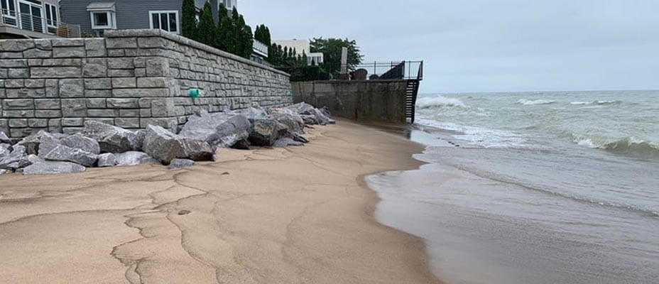 A Ledgestone texture retaining wall protects a home along Lake Michigan