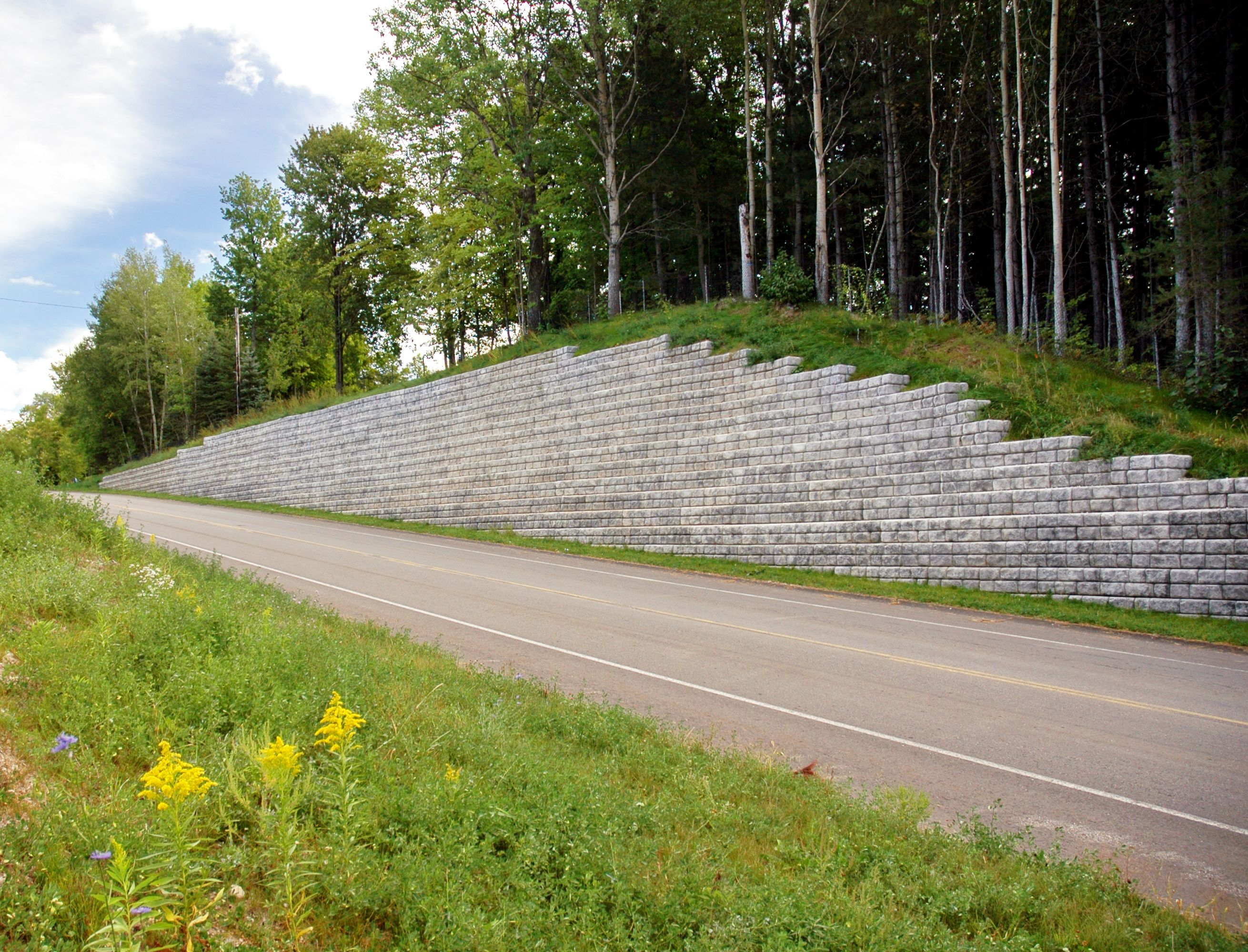 Cobblestone retaining wall along roadway