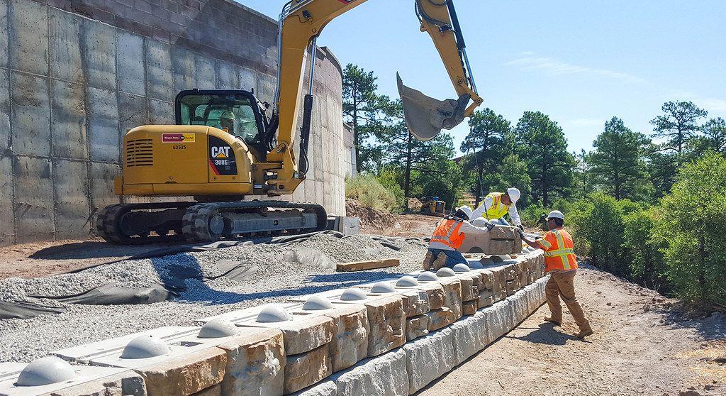 Redi-Rock Ledgestone texture blocks being installed