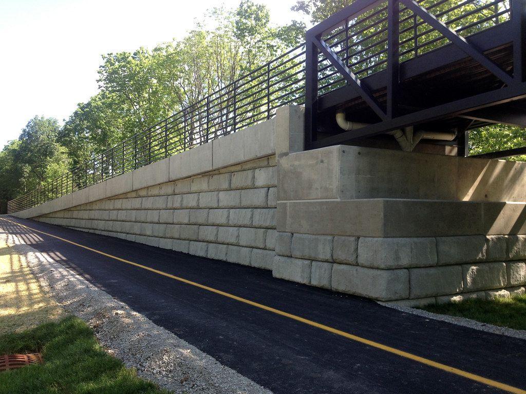 Limestone retaining walls supporting pedestrian bridge