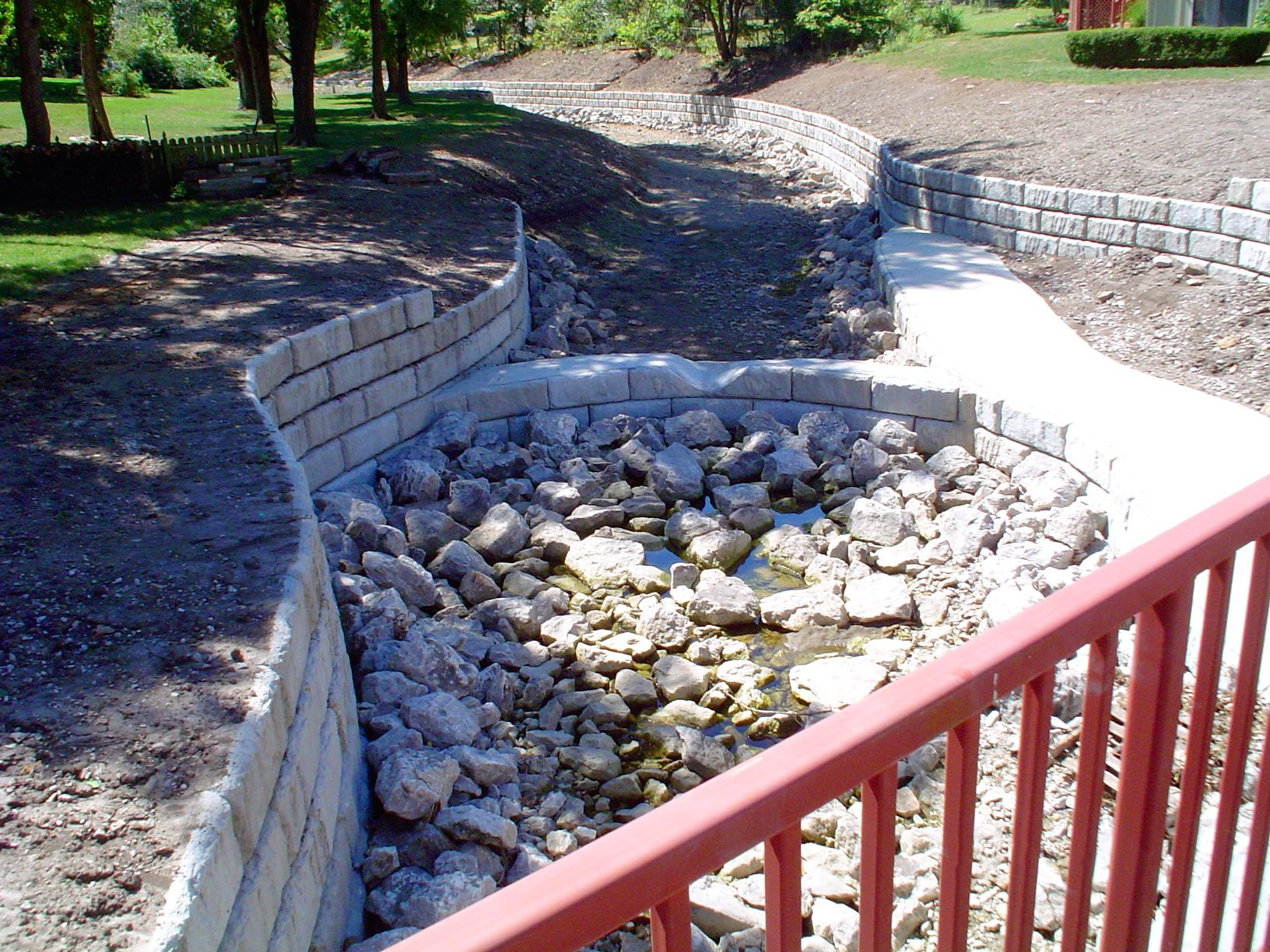 Retaining walls used to provide erosion control in channel