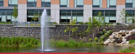Ledgestone retaining wall next to pond in front of corporate office
