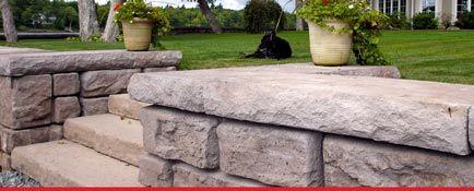 Ledgestone retaining wall and steps leading into backyard