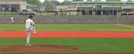 Pitches on baseball field with Cobblestone retaining wall separating the field from the road