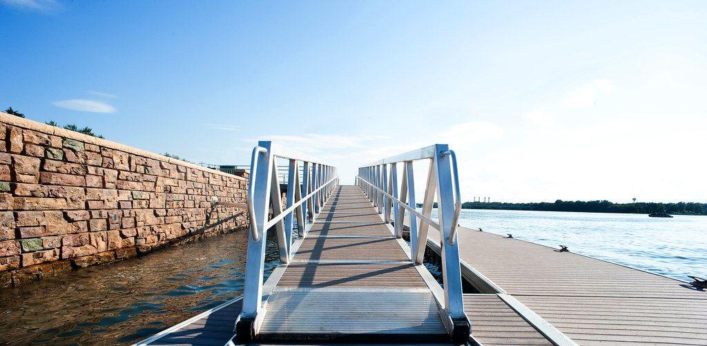 Riverfront dock with Ledgestone retaining wall protecting shoreline from erosion