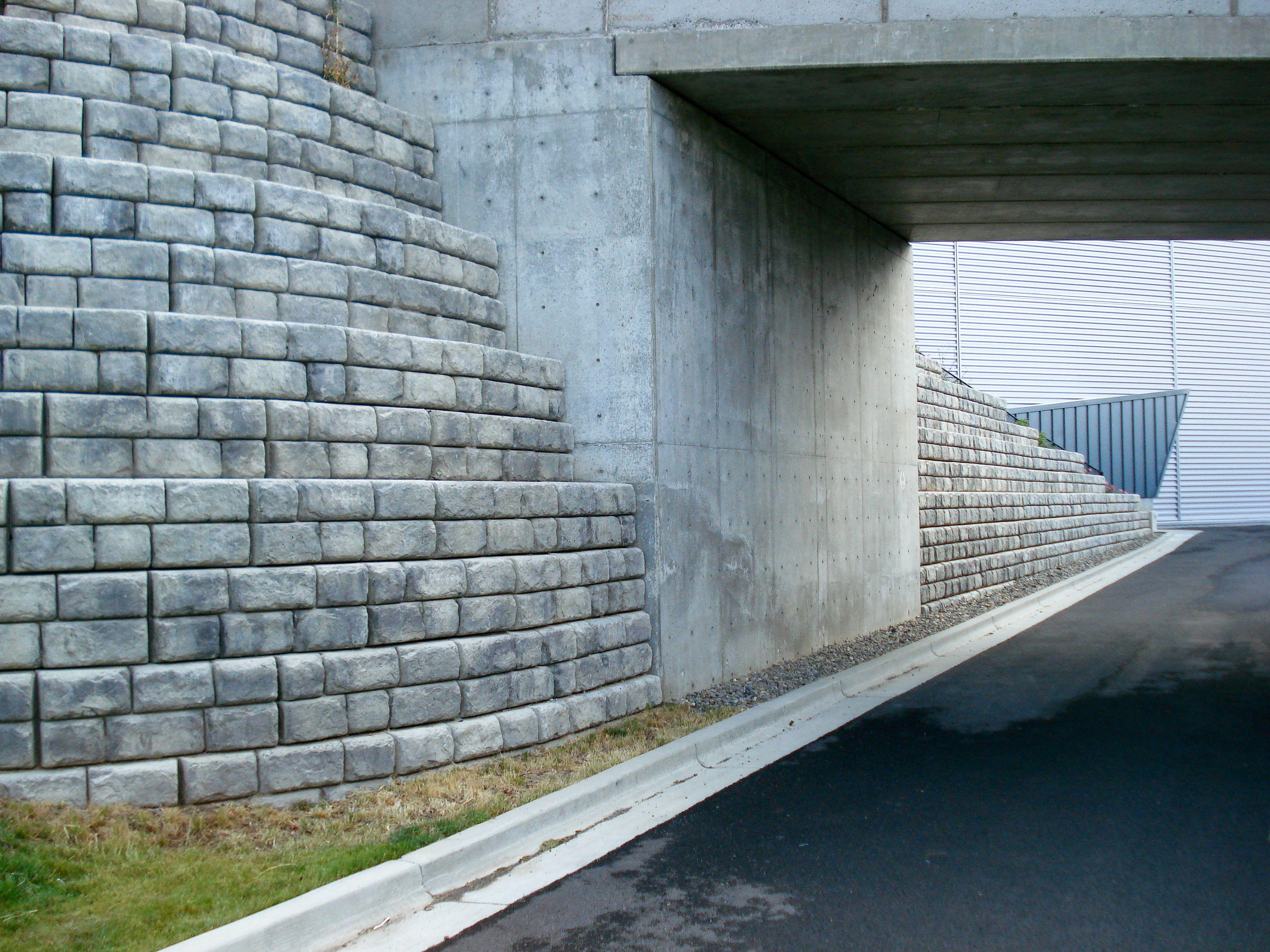 Tiered Cobblestone retaining wall with planter blocks