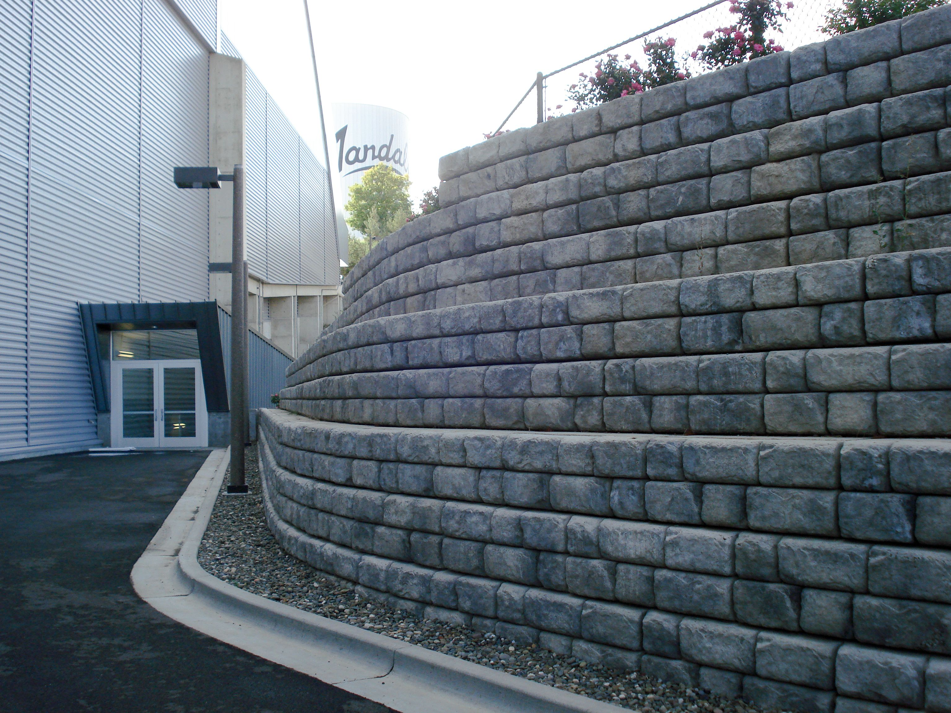 Tiered, curved Cobblestone retaining walls for campus