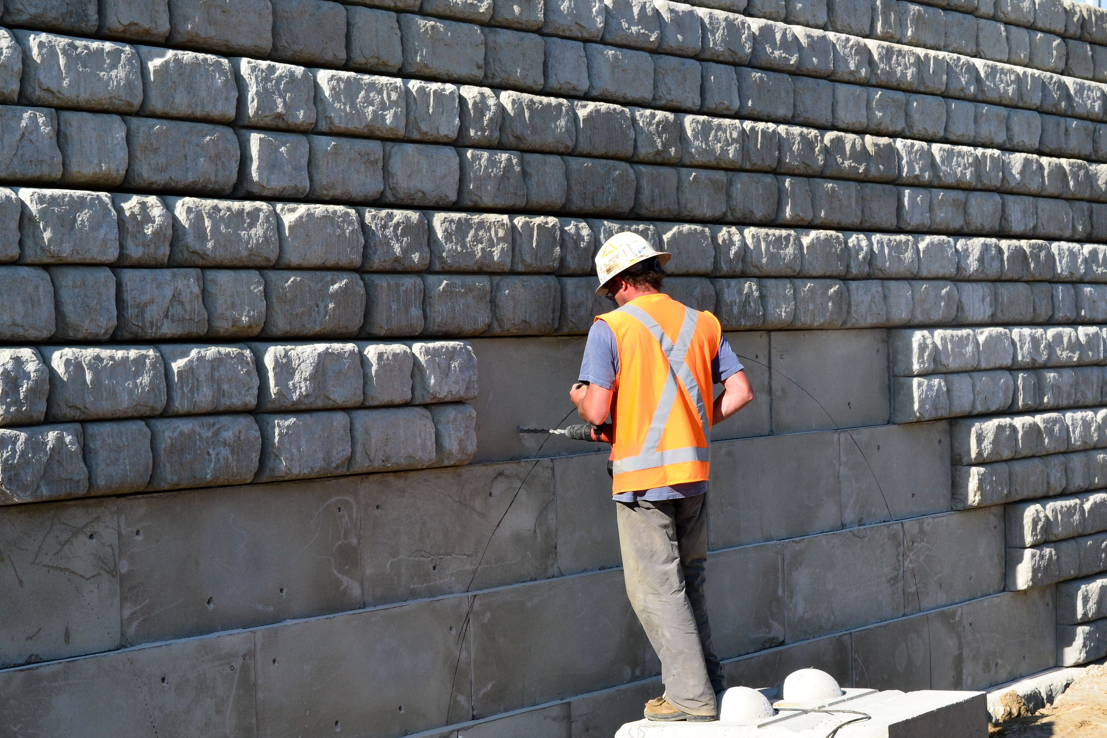 Construction worker work on wall during installation