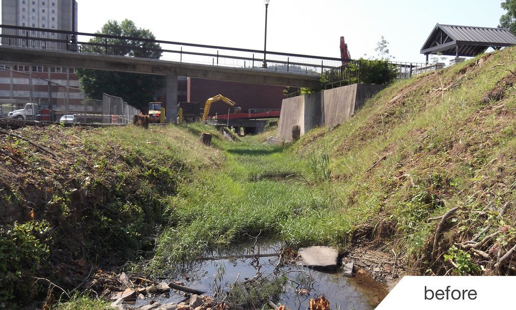 Erosion damaged storm channel before construction of new retaining walls
