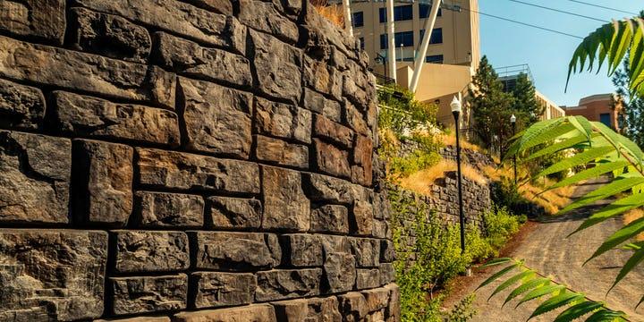 Random stacked stone aesthetic of Ledgestone retaining wall