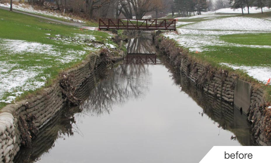 Before picture of failing channel erosion control using sand bags